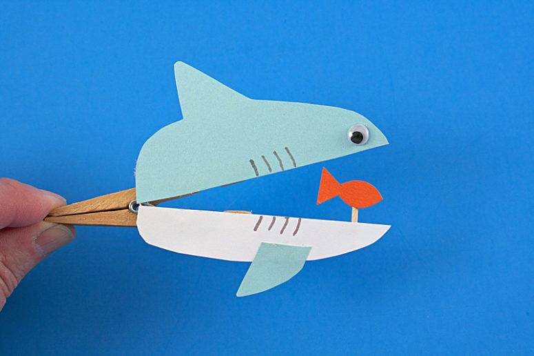 DIY clothespin shark with a fish (via www.kixcereal.com)