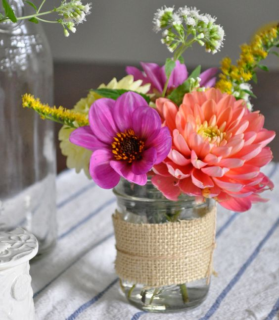 a bold floral centerpiece for a rustic-themed birthday party
