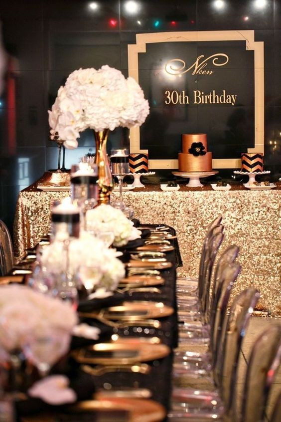 elegant glam black and gold 30th birthday party with white florals