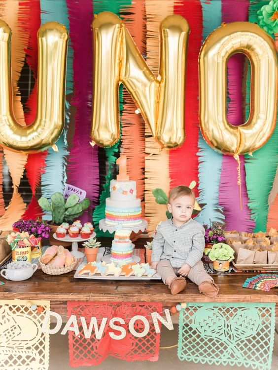 gold balloon letters for a dessert table backdrop is a popular idea