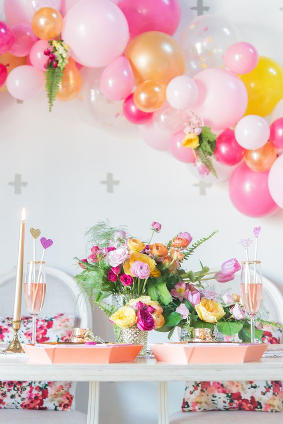 colorful balloon arch over the reception table