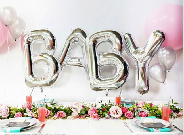 silver baby balloon letters for a backdrop