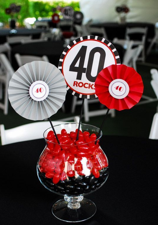 a red and black Las Vegas inspred centerpiece with candies