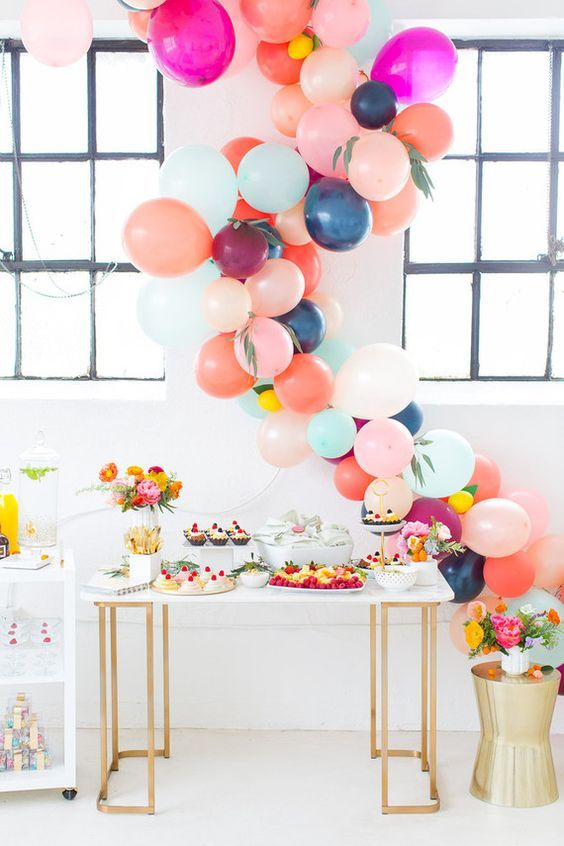 colorful balloon garland as a dessert table backdrop