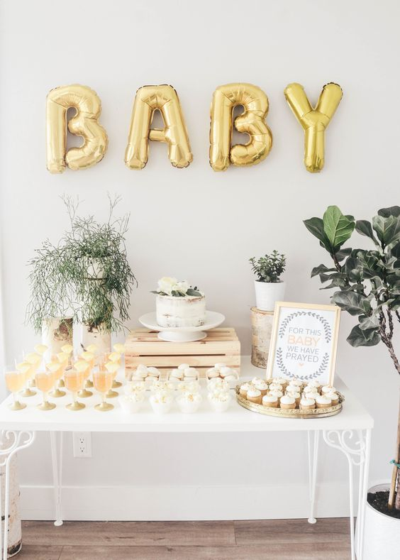 gold letter balloons for creating a backdrop