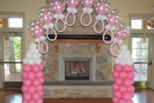 05 pink and white bottles and baby dummy balloon decorations for a girl's baby shower