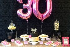 05 pink number balloons, a glitter tablecloth and glam desserts
