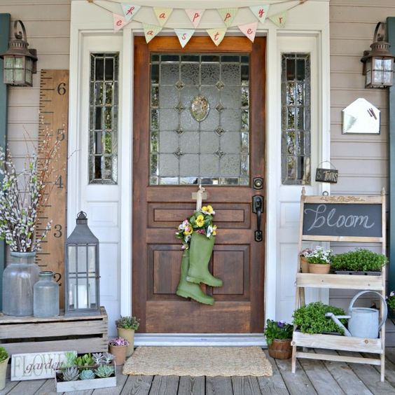 pussy willow, succulents, greenery and boots with flowers are perfect to frame the door