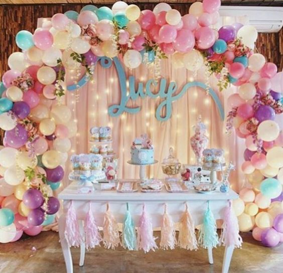 a bold balloon arch for the dessert table