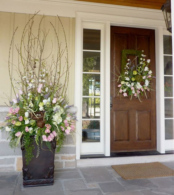 a spring wreath and a matching urn arrangement for a cool porch look