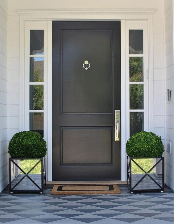 mirrored planters make the front door stand out