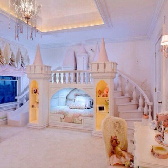 large blush castle with a slide, a bridge and storage to feel a real princess