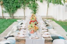 07 outdoor boho chic birthday party decor, a low table and pillows