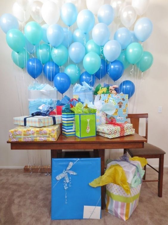 an ombre balloon wall for a gift table