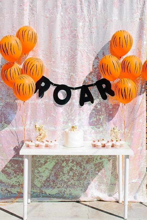 animal-printed balloons for the dessert table