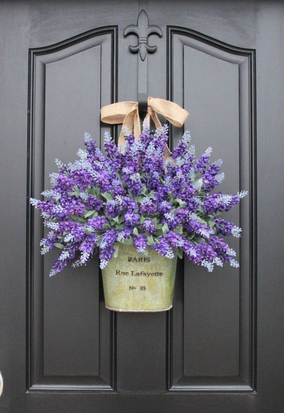 hang a bucket with flowers instead of a wreath