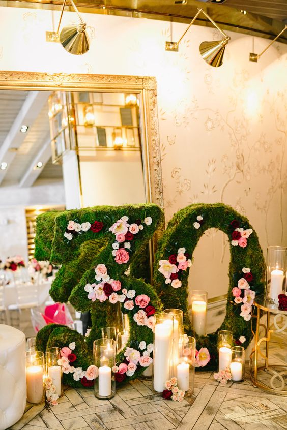 moss 30 with floral decor and lots of candles
