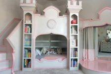 08 pink castle bed with bookshelves and a bridge ove rit