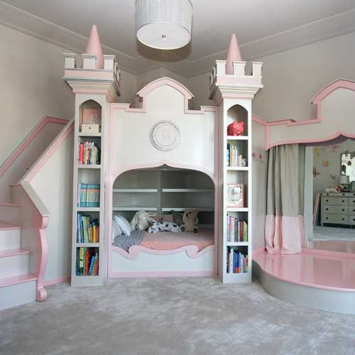 pink castle bed with bookshelves and a bridge ove rit
