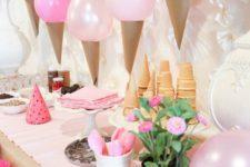 09 balloon ice cream cone garland over the dessert table