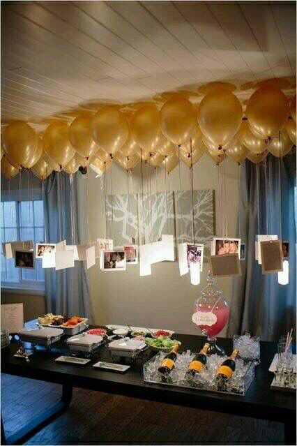simple party decor with hanging photos and balloons