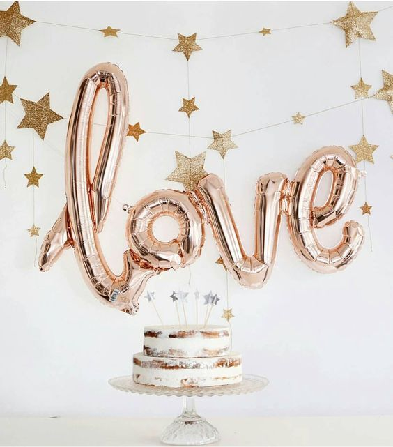 LOVE letter balloons as a dessert table backdrop