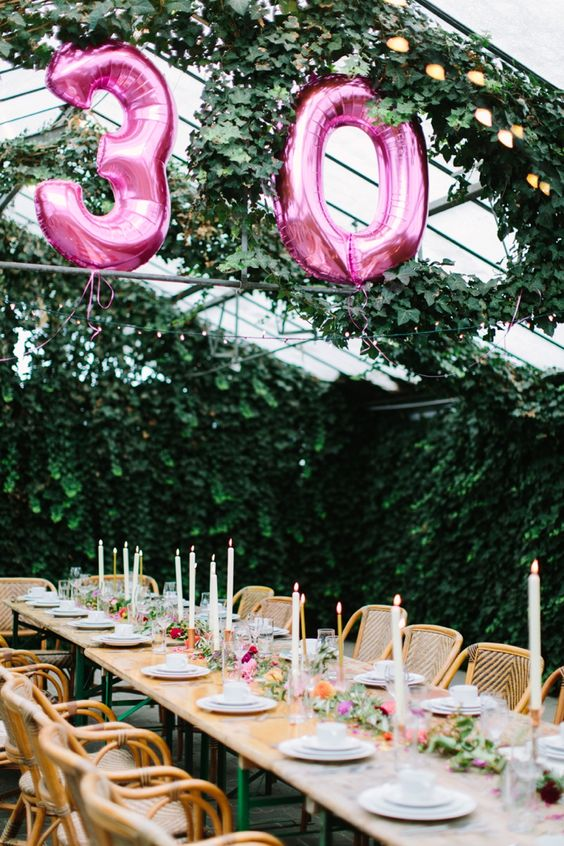 glam boho birthday table and pink number balloons