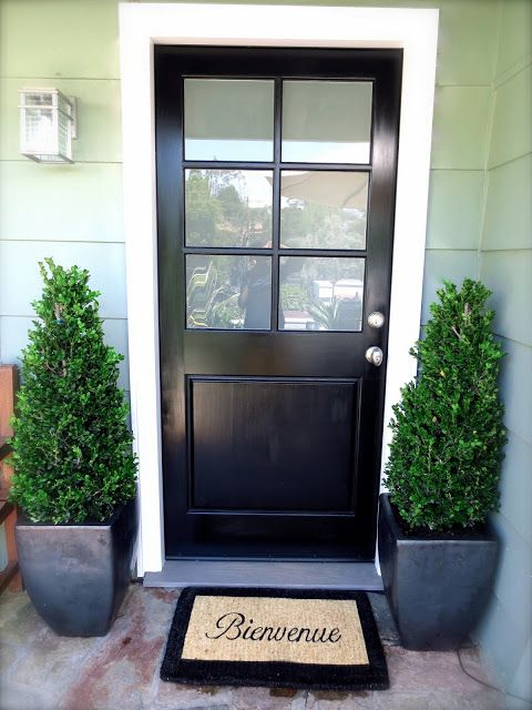 glossy black door, boxwood topiaries in charcoal grey ceramic pots