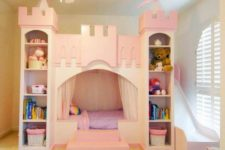 10 pink castle bed with shelves for books and toys