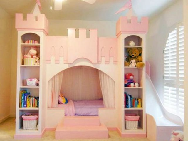 pink castle bed with shelves for books and toys