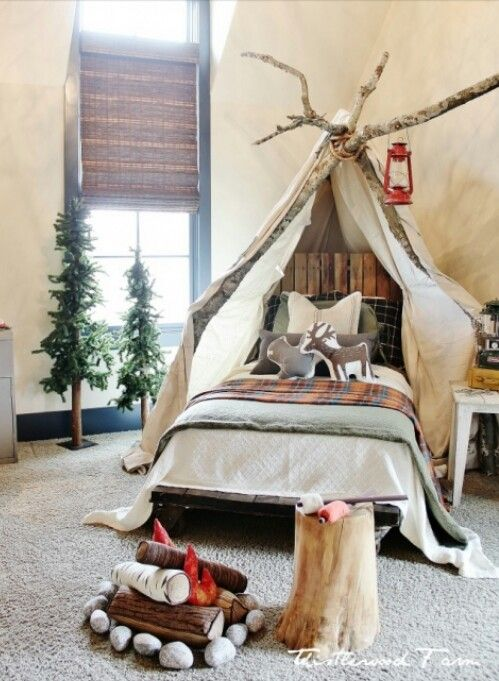 tipi bed for a fan of outdoors and a toy fire