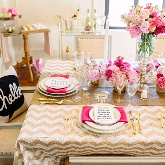 very glam table setting in gold and pink for a ladies' party