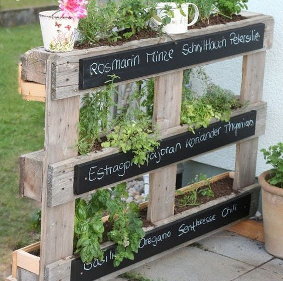 a pallet herb garden with chalkboards is a great ideaa