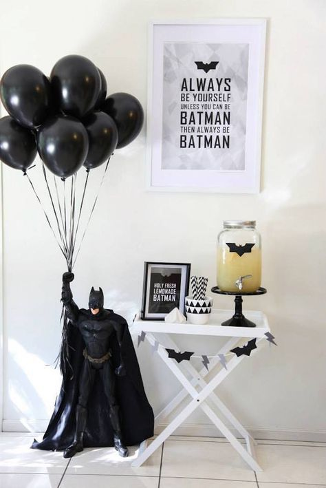 black balloons held by Batman for a boys' party
