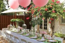 11 pink balloons attached to the table instead of a centerpiece