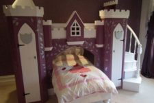 11 purple castle with a bridge and a bed incorporated