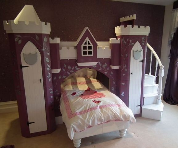 purple castle with a bridge and a bed incorporated