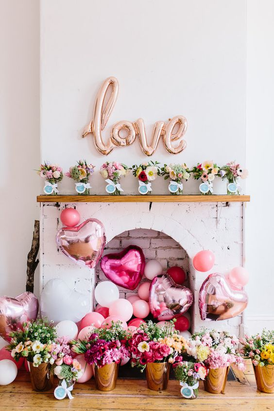 LOVE and heart-shaped balloons with bright flowers