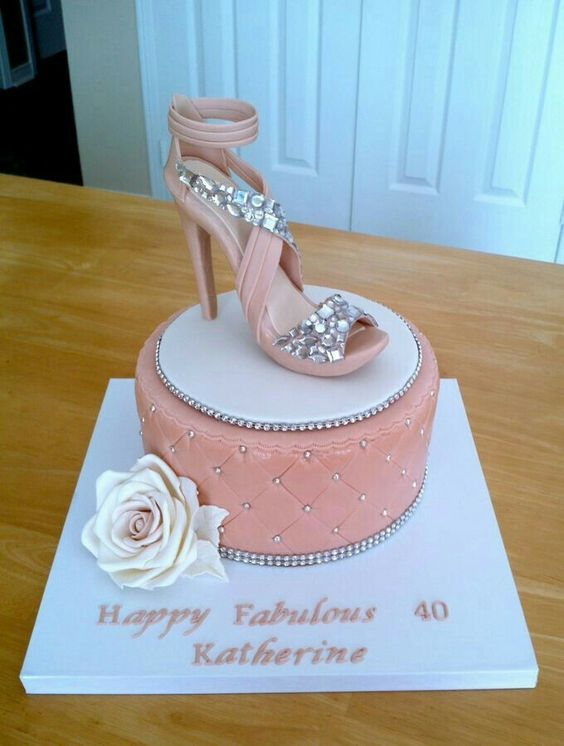 blush birthday cake topped with a psarkly shoe for real fashionistas