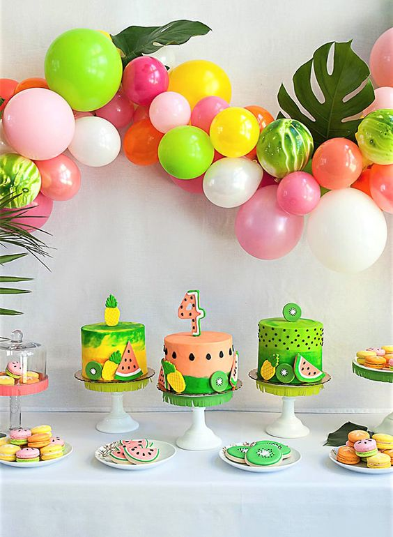 colorful balloon garland for decorating a dessert table
