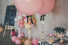 12 pink balloons with oversized gold sequins and black bows for a girl's party
