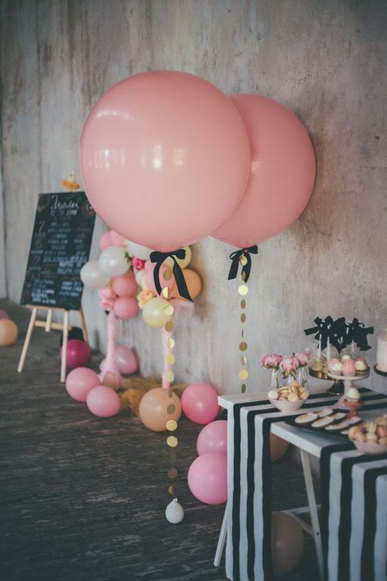 pink balloons with oversized gold sequins and black bows for a girl's party