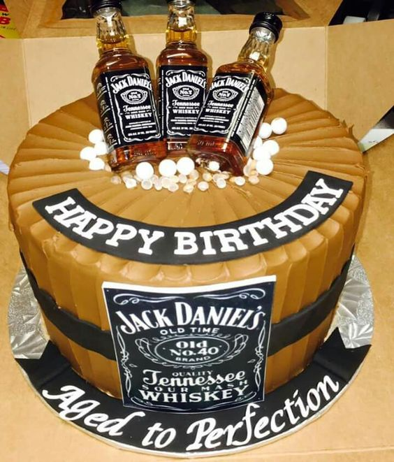 Jack Daniels b-day cake topped with bottles