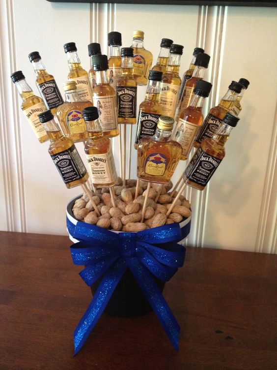 a centerpiece with small alcohol bottles on skewers