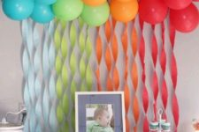 13 rainbow balloons to accentuate the dessert table