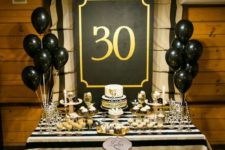 13 white, black and gold dessert table with striped decor