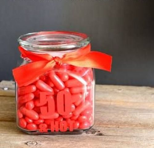 50 and hot jar filled with candies for the dessert table