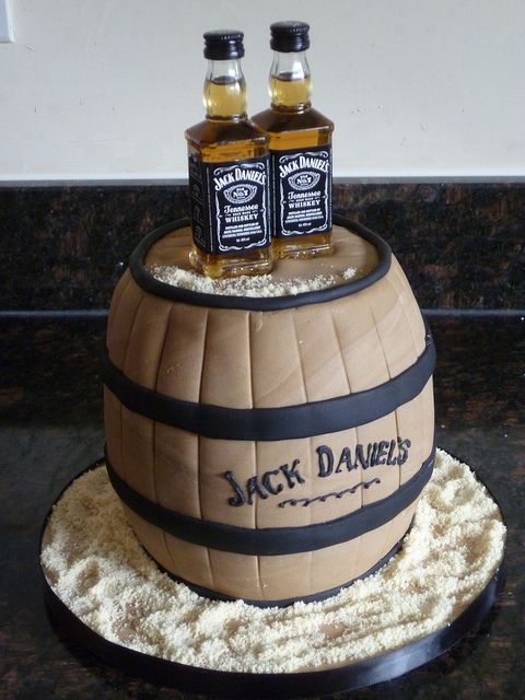 Jack Daniels cake topped with real JAck Daniels bottles