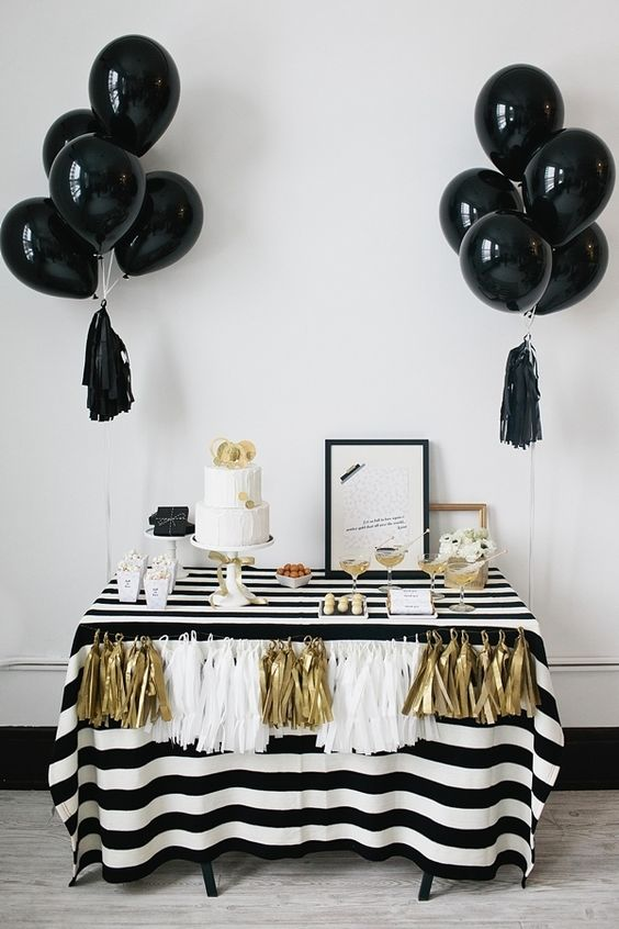 black balloons with tassels for an elegant black, white and gold dessert table