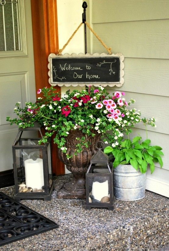 Candle Lanterns And Planters With Greenery And Flowers Is All You Need To  Refresh The Porch